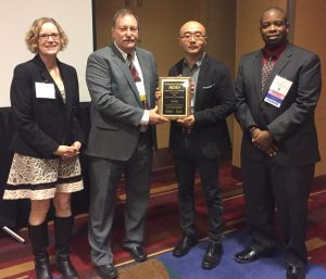 CBE's Herbert L. Stiles Professor of Chemical and Biological Engineering Yue Wu (second from right) receives the Young Investigator Award at the American Institute of Chemical Engineers Annual Meeting.