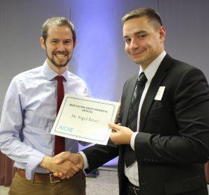 Prof. Reuel with award
