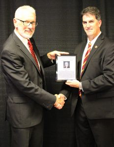 King received plaque from chair Andy Hillier