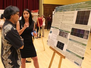 Laura Pesquera-Colom with research poster