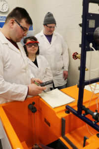Students with new lab equipment