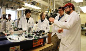 Lab superisor Ryan Arndorfer with students and lab equipment